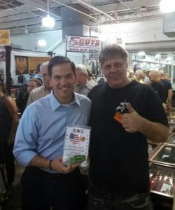 (Marco Rubio)7-23-16 in the Jacksonville Florida gun show getting him self a New Patent Block knife sharpener from inventor of the Block knife sharpener Paul Block.