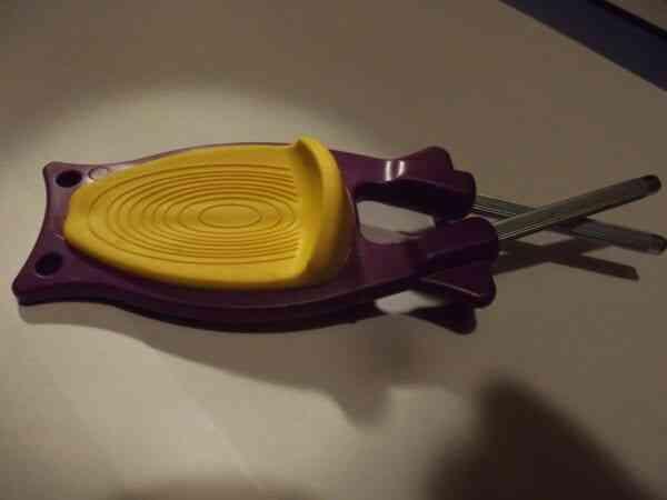 Show Patent thumb guard on the Block's Knife sharpener.